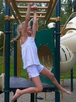 Carys on the bars - july 2012