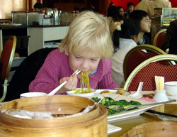Feb08_carys_uses_chop_sticks